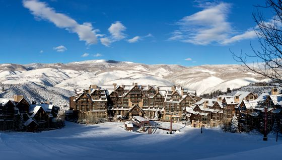 Snow-covered buildings in a mountain valley