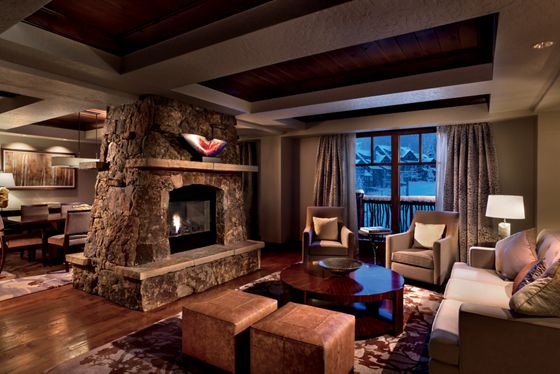 A living area faces a stone fireplace