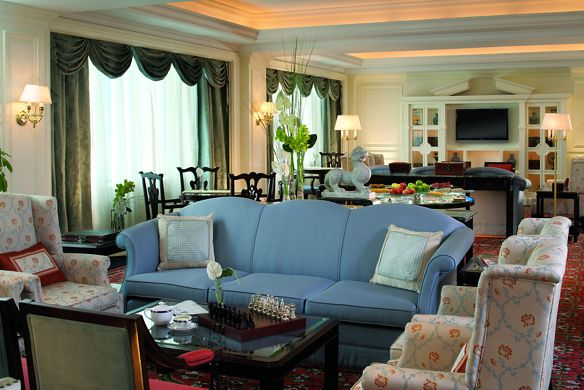 Elegant living room with a dining table and wall-mounted flat-screen TV