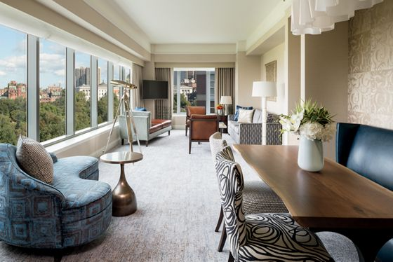 The living area at The Ritz-Carlton, Boston, overlooking Boston Common and the Public Gardens.