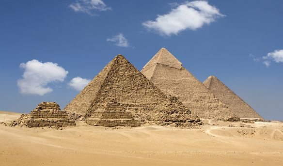 Pyramids and desert against a bright blue sky