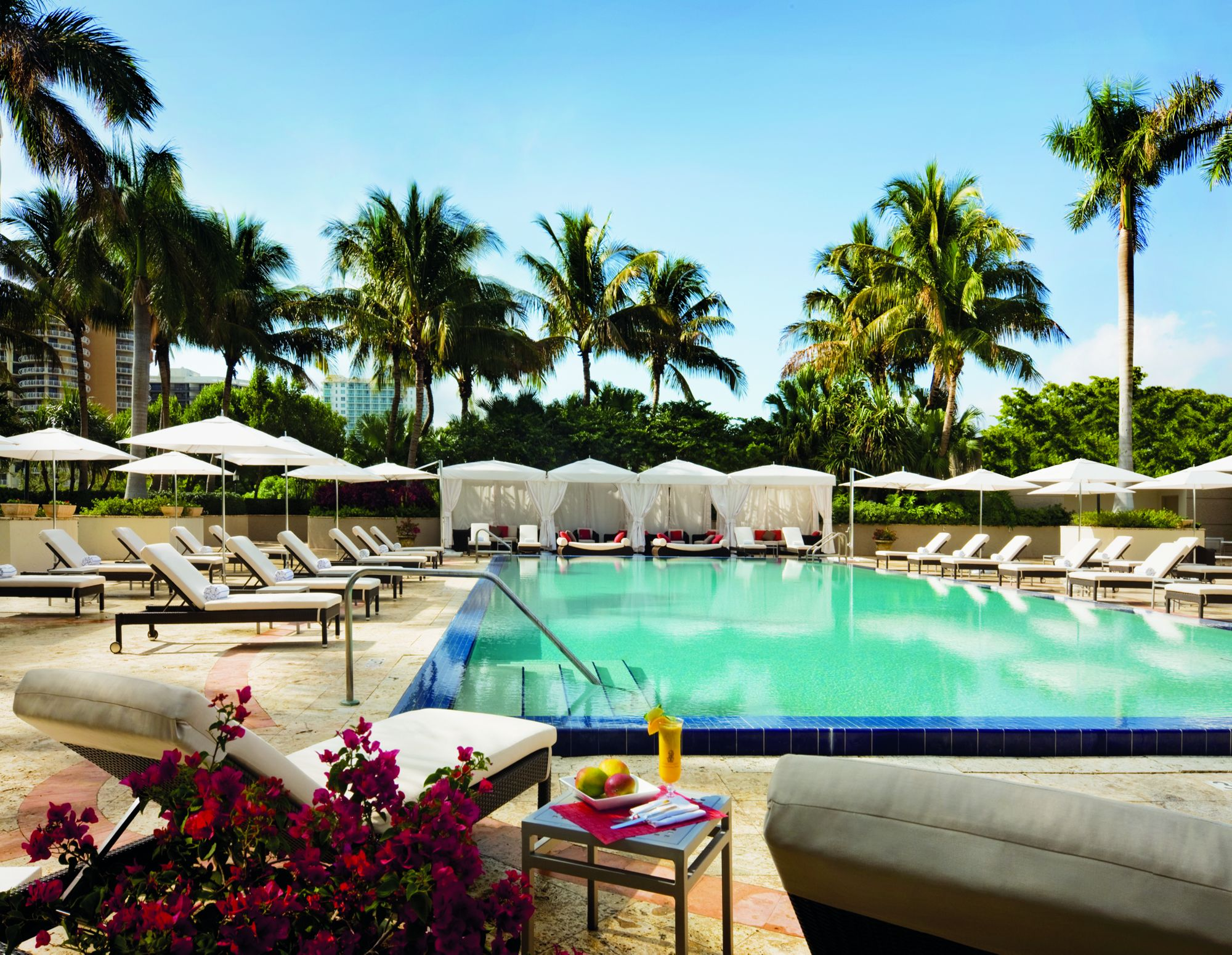 Cabanas surround the hotel's tropical pool deck