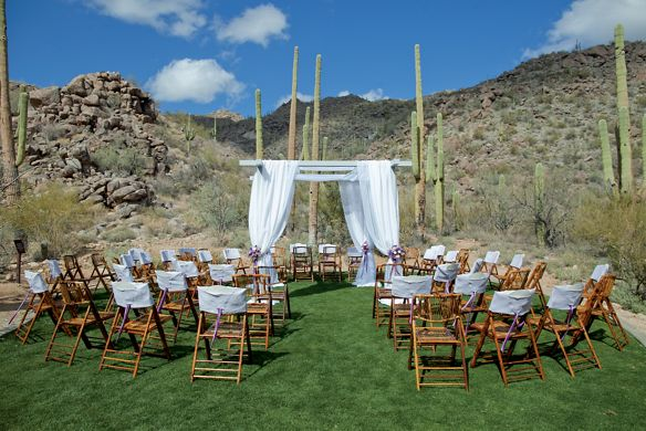 A gazebo and rows of chairs in the desert