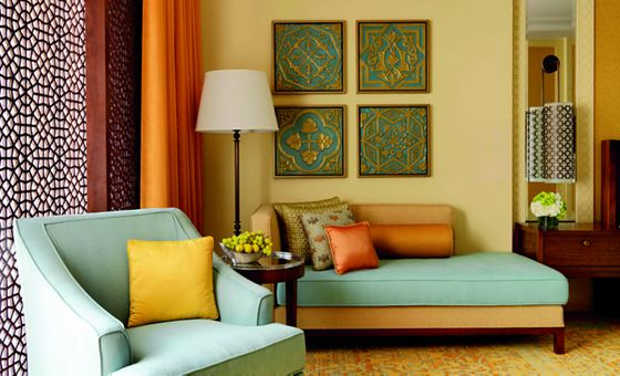 Deluxe Guest Room sitting area designed with a soothing color palette