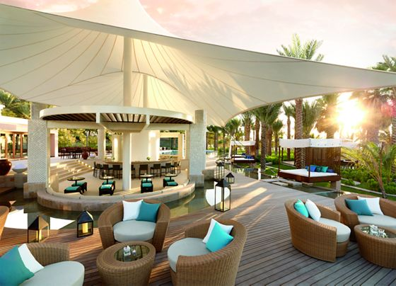 Casual luxury surrounds La Baie Lounge, an outdoor poolside restaurant