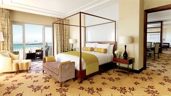 Contemporary styling of the Ritz-Carlton Suite, featuring a balcony with sea view