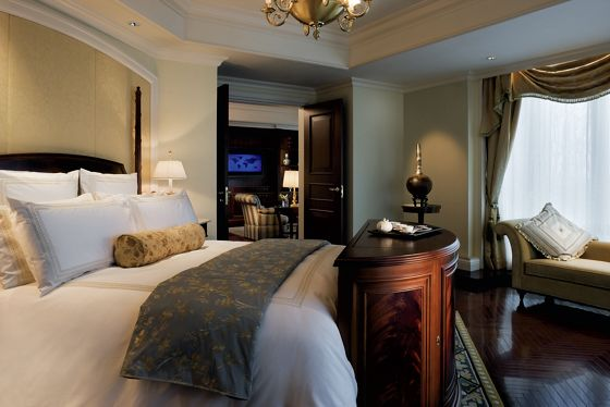 A large bedroom with elegant furnishings