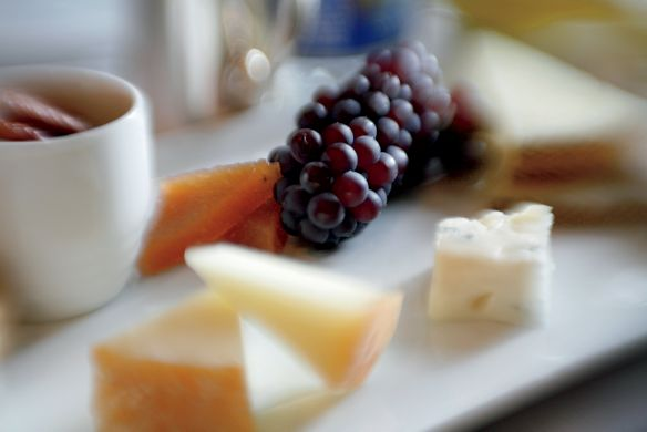 A plate with cheese and fruit