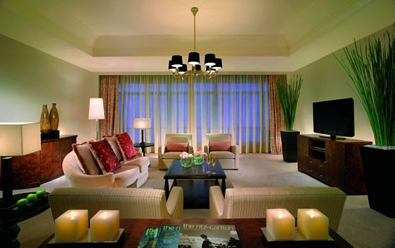 Living room with a sofa, four armchairs, a coffee table and flat-screen TV