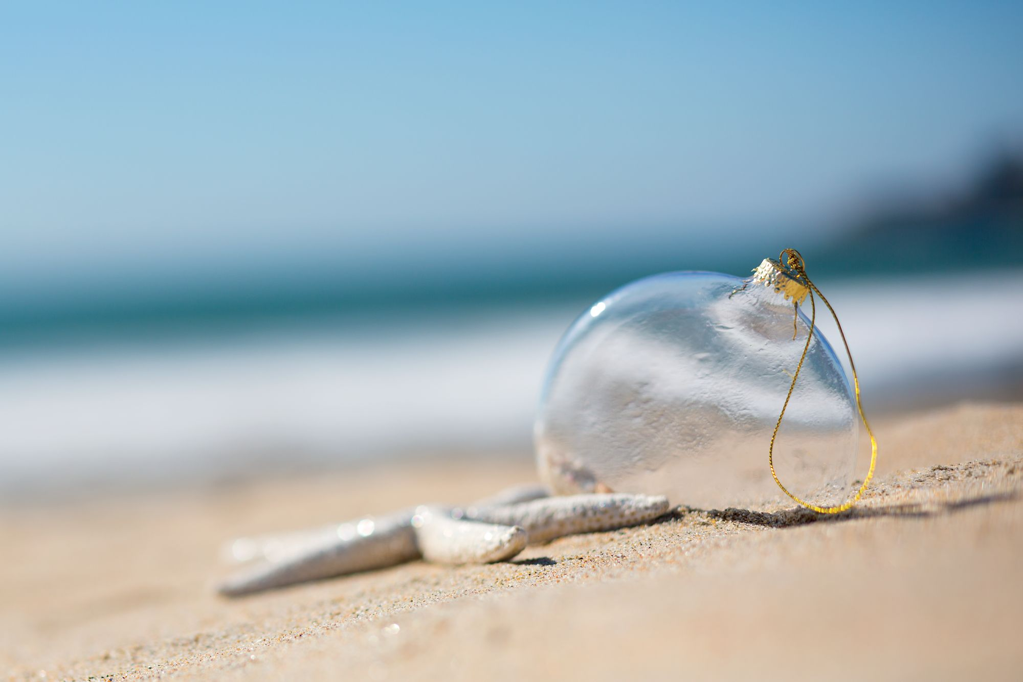 A glass ball in the sand