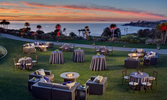 Lounge-like setup on an ocean-view lawn