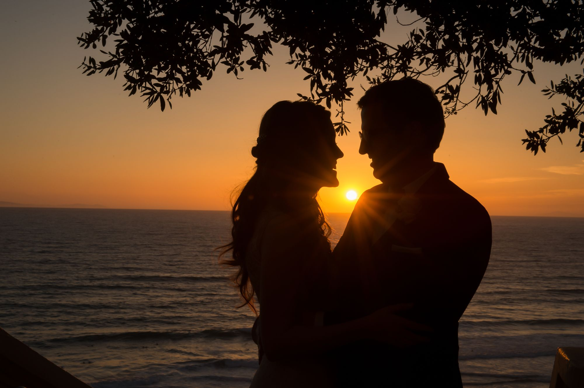 Couple embracing at sunset