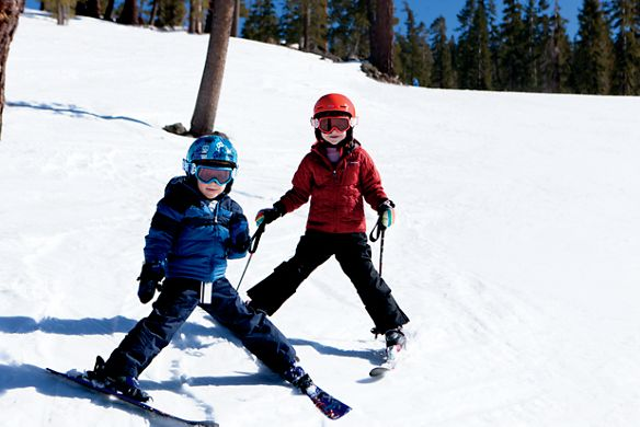 Two kids on skis in the snow