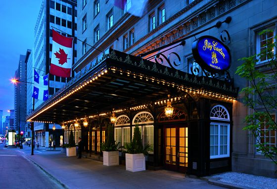 The front entrance of the hotel lit up in the evening off of Sherbrooke Street in Montreal