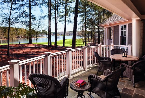 A furnished porch overlooking the lake