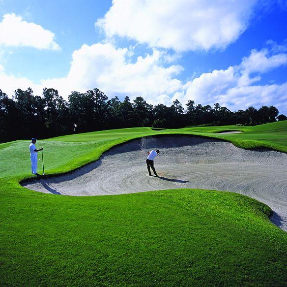 Two men playing golf