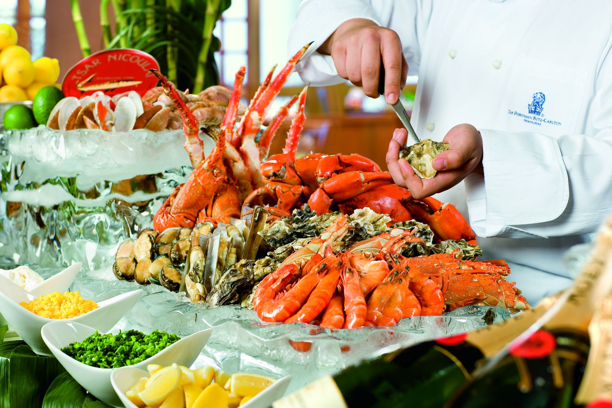 Chef puts the finishing touches on a lavish seafood buffet