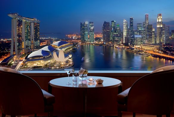 Dramatic view of the sea and city from the Club Level at The Ritz-Carlton, Millenia Singapore