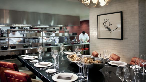 A sophisticated Chef's Table in the heart of the white-tiled kitchen at TOCA
