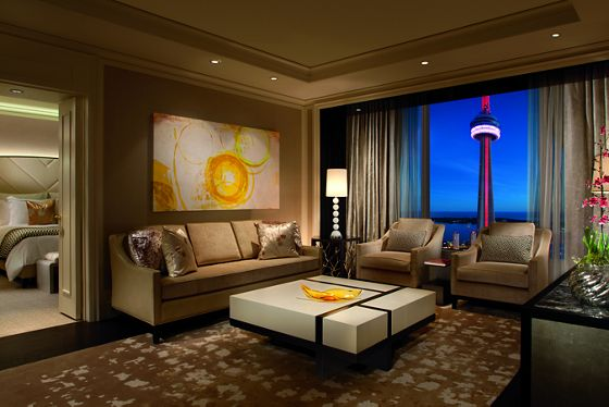 Contemporary art and clean lines are paired with plush textiles and stunning views in the Simcoe Suite Living Room