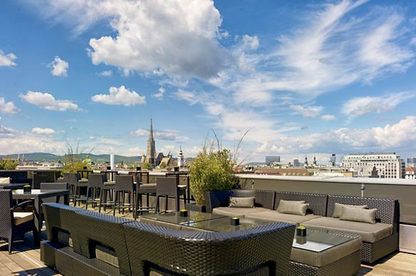 Rooftop bar with lounge seating, all under cerulean skies
