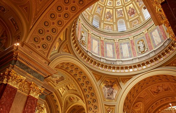 Looking up at two domes with detailed design work