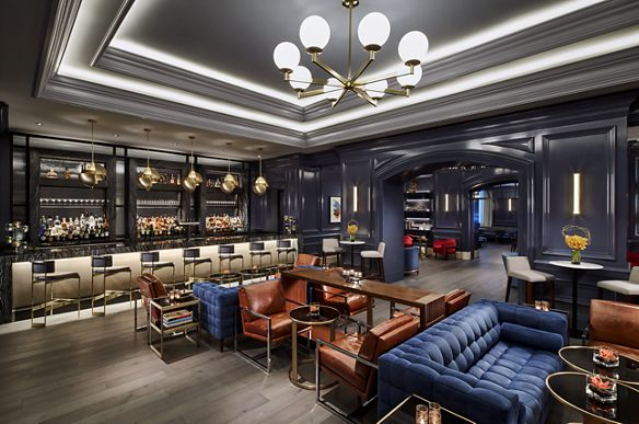 A sleek lounge with seating areas and a bar