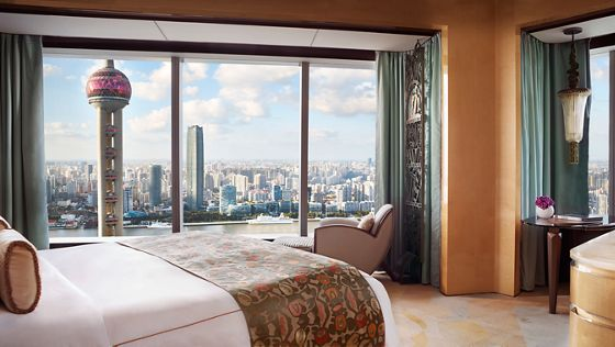 Guest room with two sets of floor-to-ceiling windows overlooking the Oriental Pearl Tower