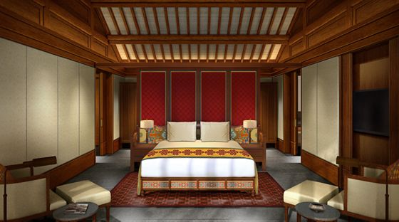 A room with a king bed and traditional, simple furniture