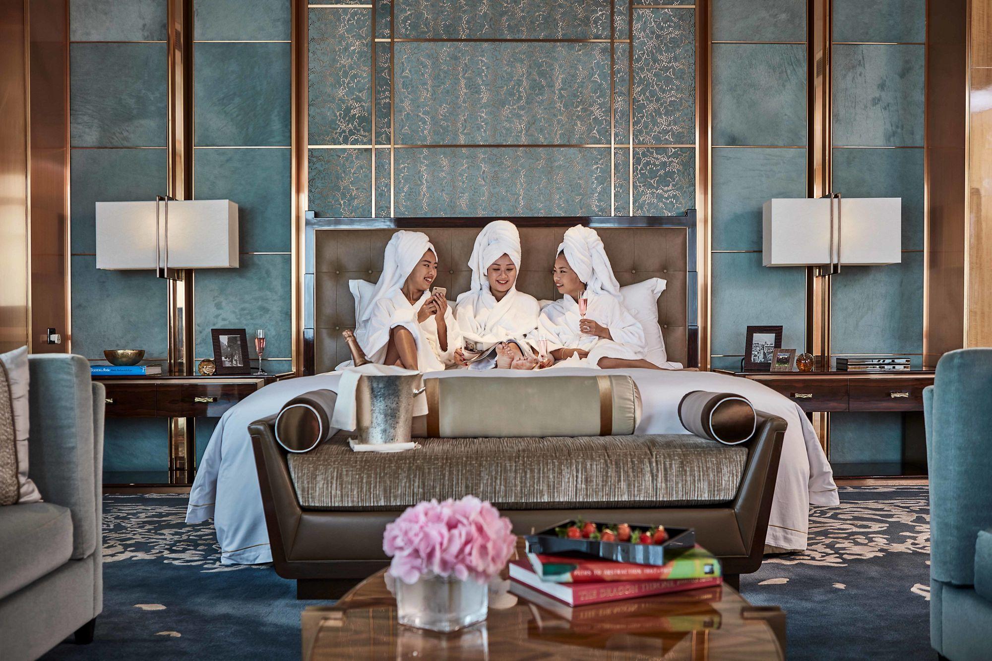 The Ritz-Carlton Suite bedroom with ladies