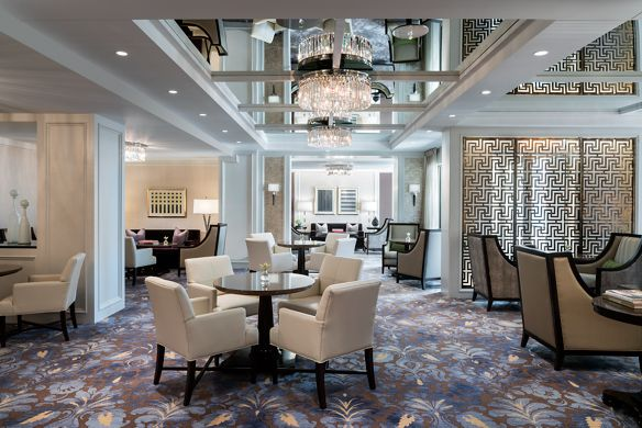 Large room with numerous seating and dining areas and elegant décor