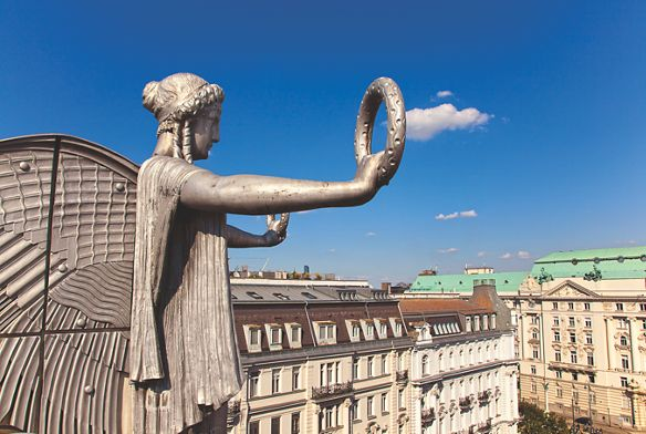 A statue of an angel overlooks the Ringstrasse in Vienna