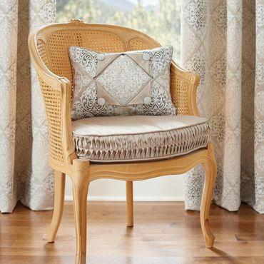 Chair Cushion with Ripple Pleat Boxing and a Pillow with Layered Design Details
