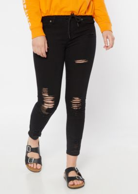 Black Distressed Mid Rise Ankle Jeggings by Rue21