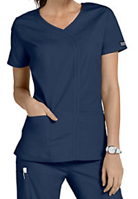 Cherokee Workwear asymmetrical mock-wrap scrub top.
