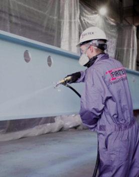 Spraying M90/03 onto a steel beam