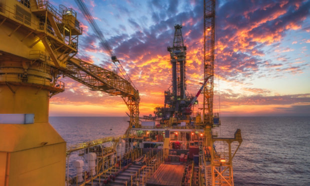 An offshore oil rig at night