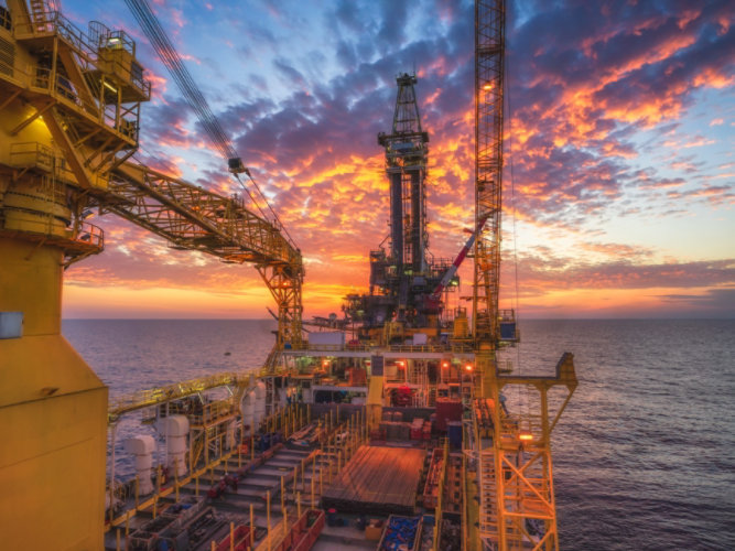 offshore drilling site at sunset