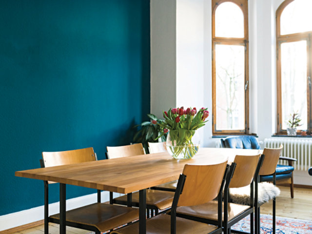 table with teal wall