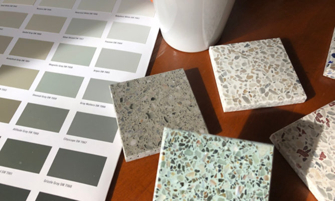 flooring samples and color card on table