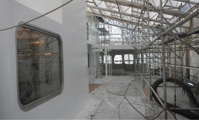 The WSF's M/V Kaleetan's structure in the process of being coated