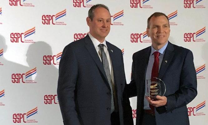 Mark Schultz accepts the SSPC John D. Keane Award of Merit