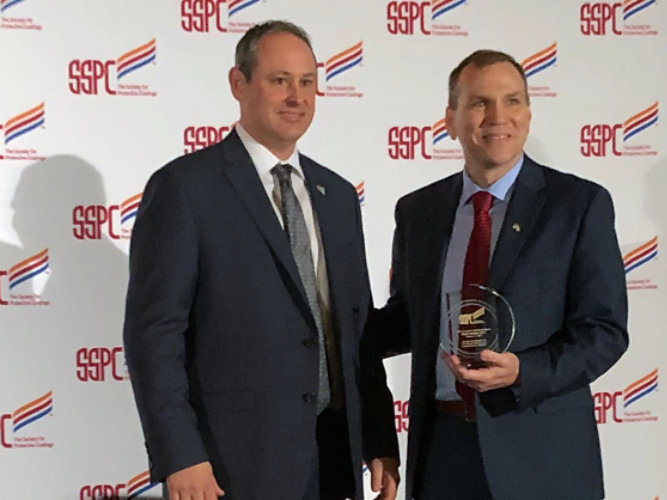 Mark Schultz accepting the SSPC John D Keane Award of Merit