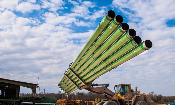Oil and gas underground pipes being carried by forklift