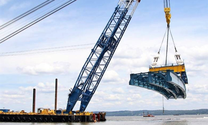 crane bringing in piece of bridge to be installed