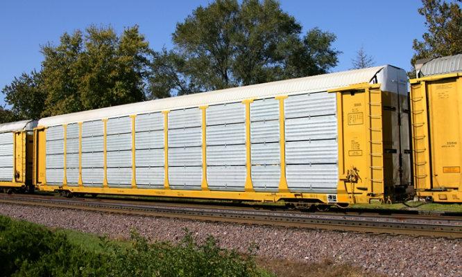 A yellow rail car