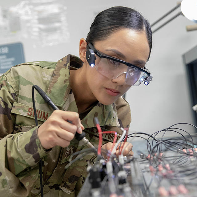 Air National Guard with goggles working on technical systems
