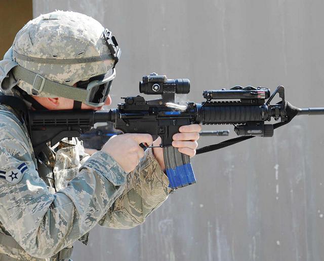 Airmen firing rifle