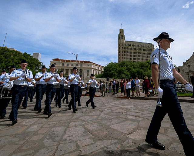 Trainees march past The Alamo