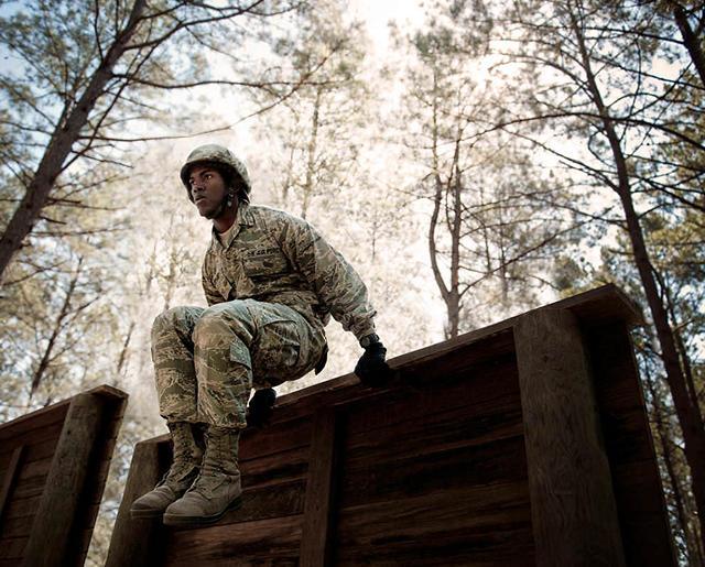 Airman hurdles an obstacle